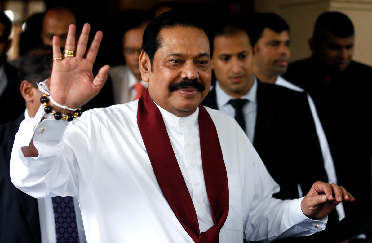 Sri Lanka's newly appointed Prime Minister Mahinda Rajapaksa waves at the staff after participating in the ceremony to assume his duties as the Minister of Finance and Economic Affairs at the Finance Ministry in Colombo, October 31, 2018. Reuters