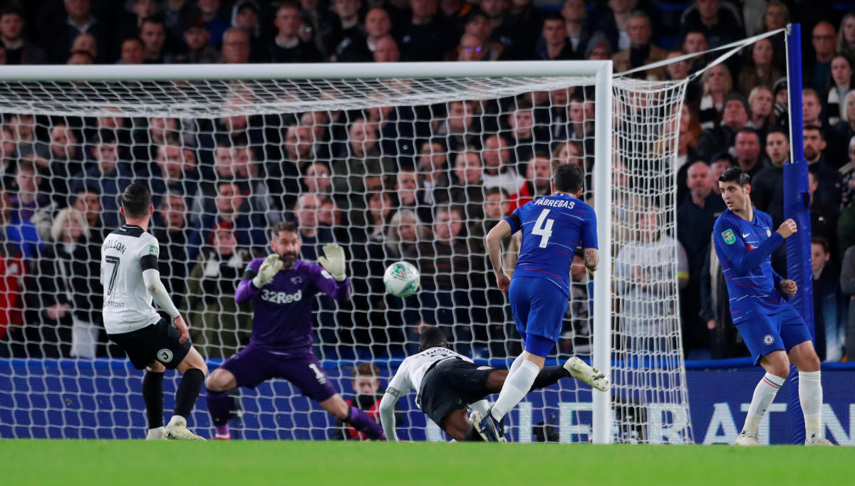 SEALING THE DEAL: Chelsea's Cesc Fabregas (second from right) scores the winner during their League Cup clash against Derby County. Reuters