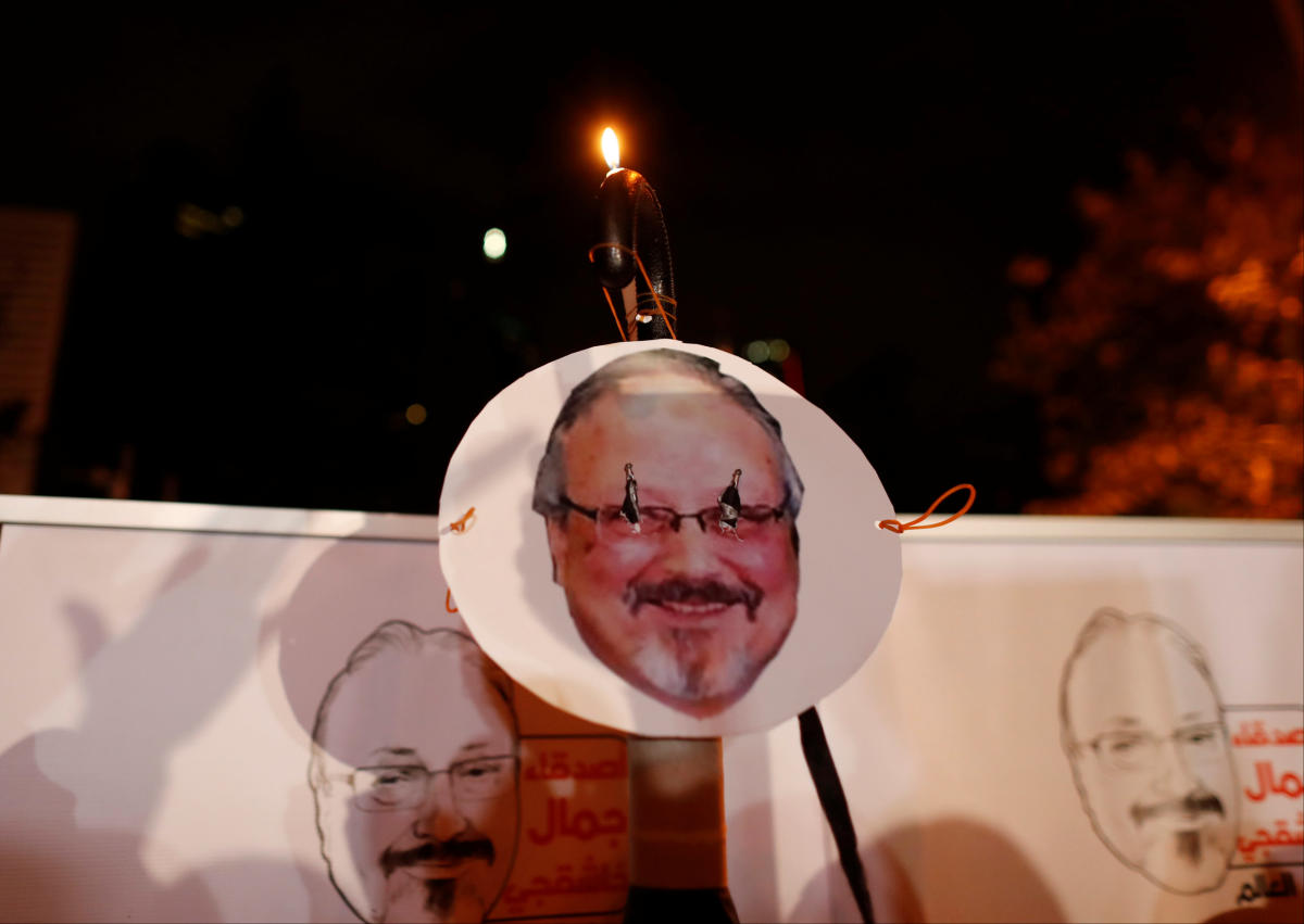 Demonstrators hold placards with a picture of Saudi journalist Jamal Khashoggi outside the Saudi Arabia consulate in Istanbul, Turkey October 25, 2018. (Reuters File Photo)
