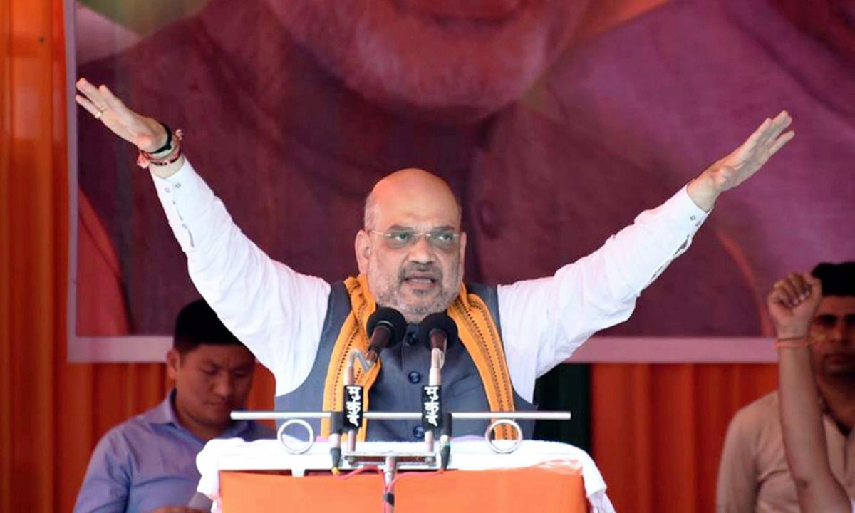 BJP president Amit Shah addresses an election rally in Ambagarh Chowki town under Khujji Assembly constituency of Rajnandgaon district of Chhattisgarh on Sunday. PTI