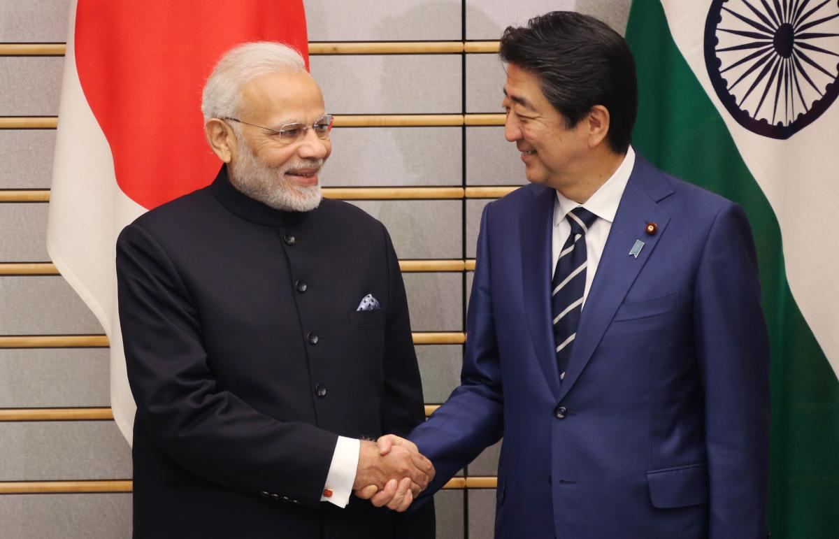 Indian Prime Minister Narendra Modi (L) shakes hands with Japan's Prime Minister Shinzo Abe prior to their meeting at Abe's official residence in Tokyo on October 29, 2018.AFP