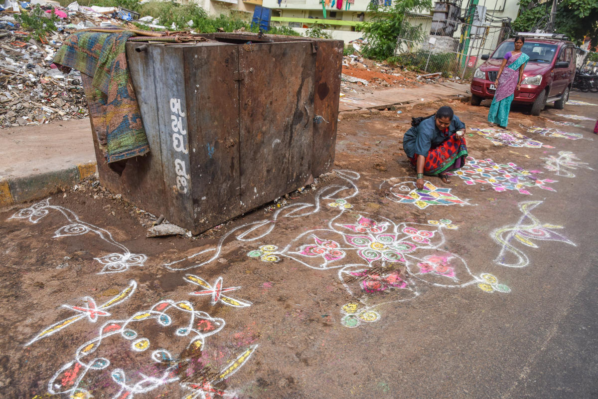 Civic apathy: Sanitation workers had cleared garbage from the black spots and drew rangolis in order to prevent people from littering. DH file photo
