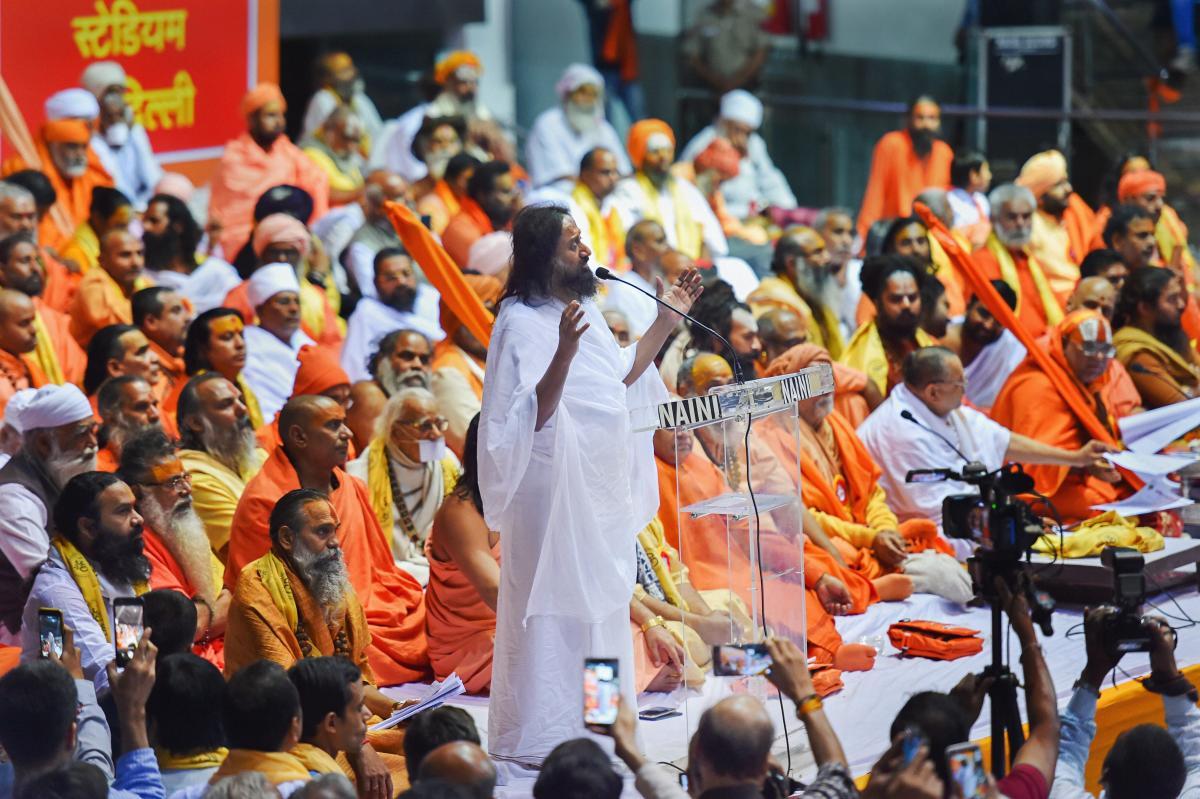 Spiritual guru Sri Sri Ravi Shankar addresses the 'Dharmadesh', a two-day meeting of Hindu seers organised for national integration, at Talkatora Stadium, in New Delhi. PTI