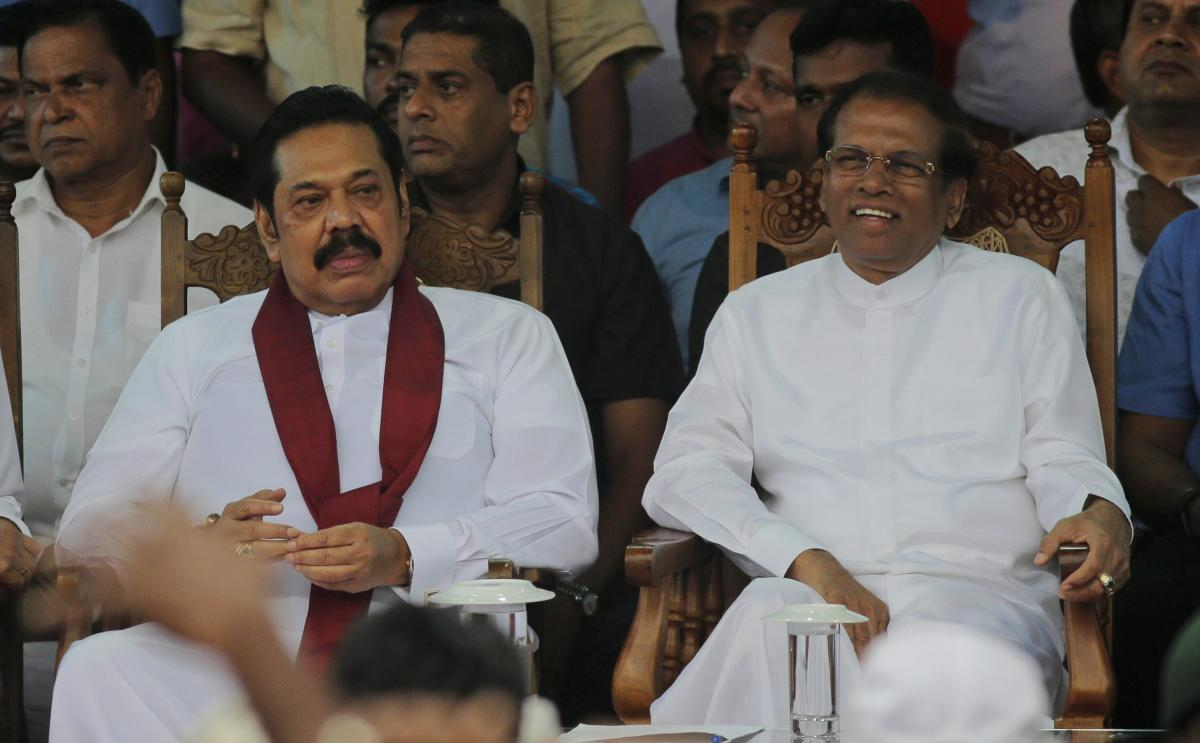Sri Lankan president Maithripala Sirisena, right, and his newly appointed prime minister Mahinda Rajapaksa attend a rally held out side the parliamentary complex in Colombo, Sri Lanka, Monday, Nov. 5, 2018. Thousands of Sri Lankans marched Monday in suppo