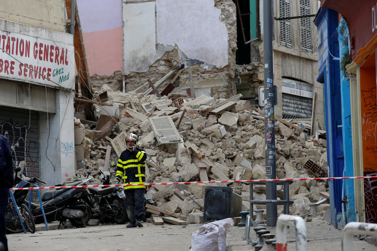 French rescue workers are seen near rubble after buildings collapsed in central Marseille. Reuters photo
