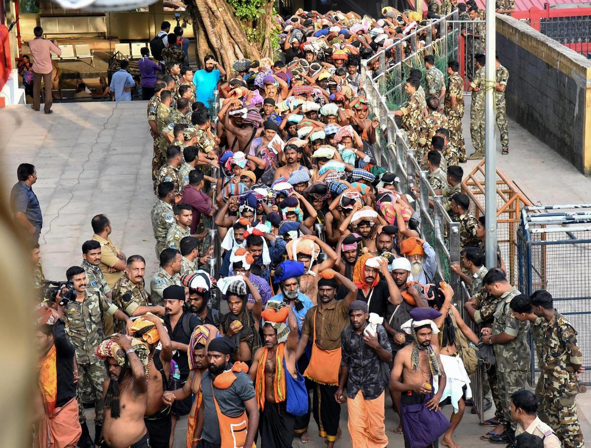 Devotees arrive at Sabarimala Temple, in Pathanamthitta District on Monday. This is the second time the hill temple will open for 'darshan' after the Supreme Court allowed entry of women of all age groups into it. PTI