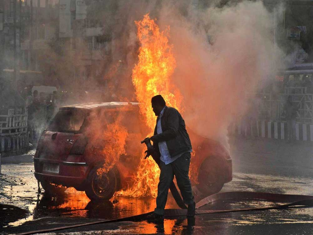 The police said 14 two-wheelers and four cars were set on fire by the accused. PTI file photo for representation