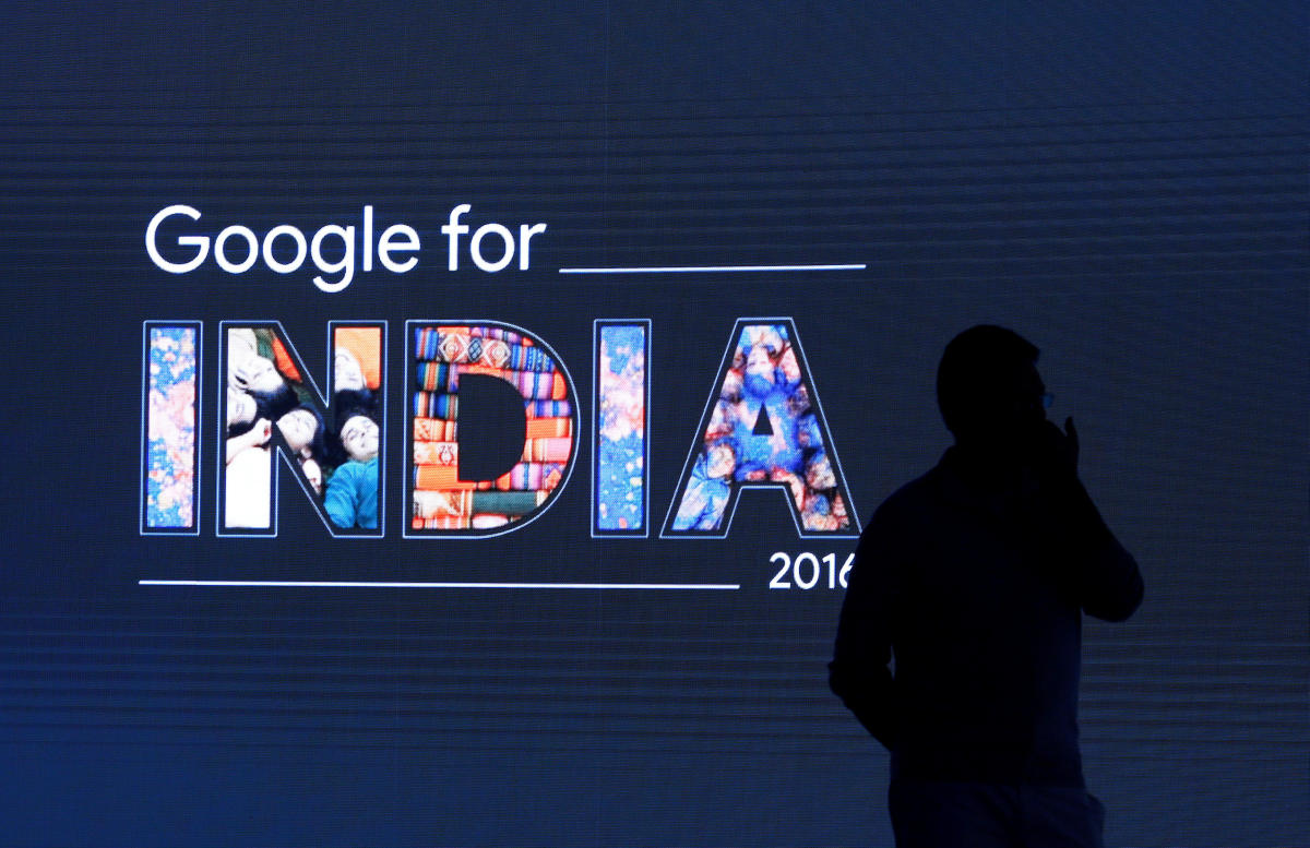 FILE PHOTO: A man stands in front of a screen during a Google event in New Delhi, India September 27, 2016. REUTERS/Adnan Abidi/File Photo
