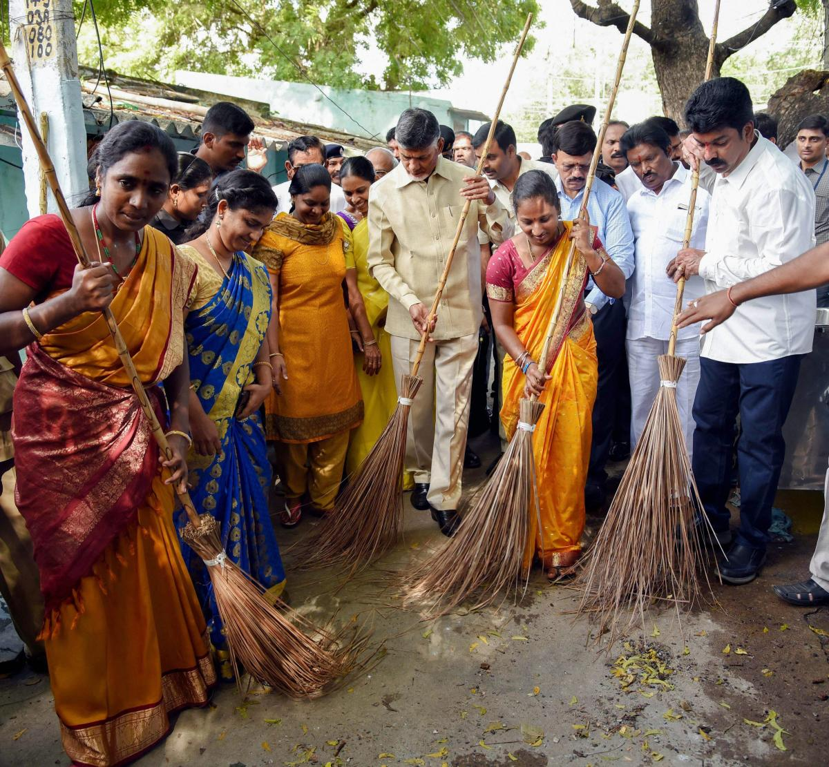 Andhra Pradesh Chief Minister Chandrababu Naidu participates in a cleanliness drive on the occasion of 'Gandhi Jayanti', in Vijayawada, on Tuesday. PTI