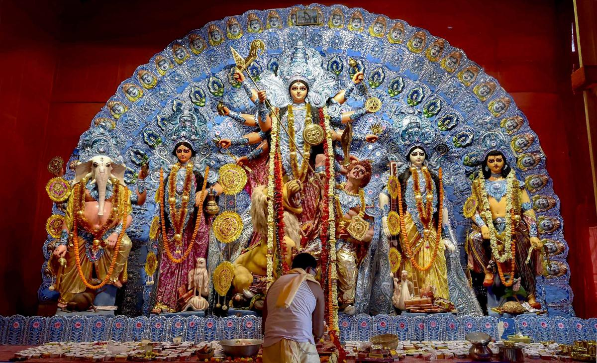 """A priest offers Maha Ashtami """"Sandhi Puja"""" at a Puja pandal during the ongoing Durga Puja festival, in Kolkata. PTI file photo"""