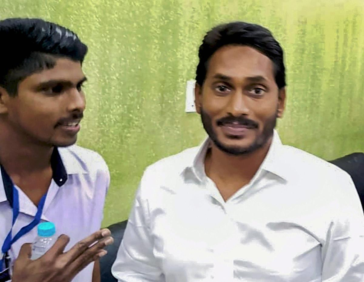 J Srinivasa Rao (L), before he stabbed the arm of YSR Congress Party chief Jagan Mohan Reddy at Visakhapatnam Airport on Thursday last. PTI file photo