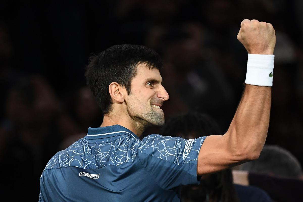 Serbia's Novak Djokovic celebrates after winning against Switzerland's Roger Federer. AFP