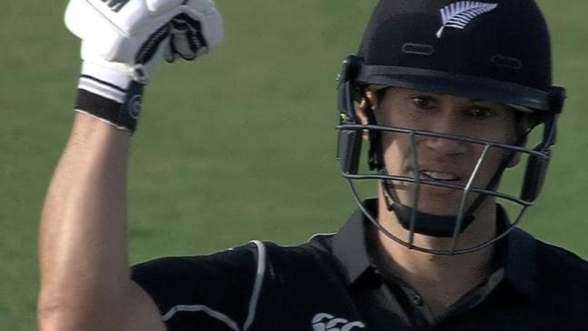 Ross Taylor gestures with a bent arm questioning Hafeez's action