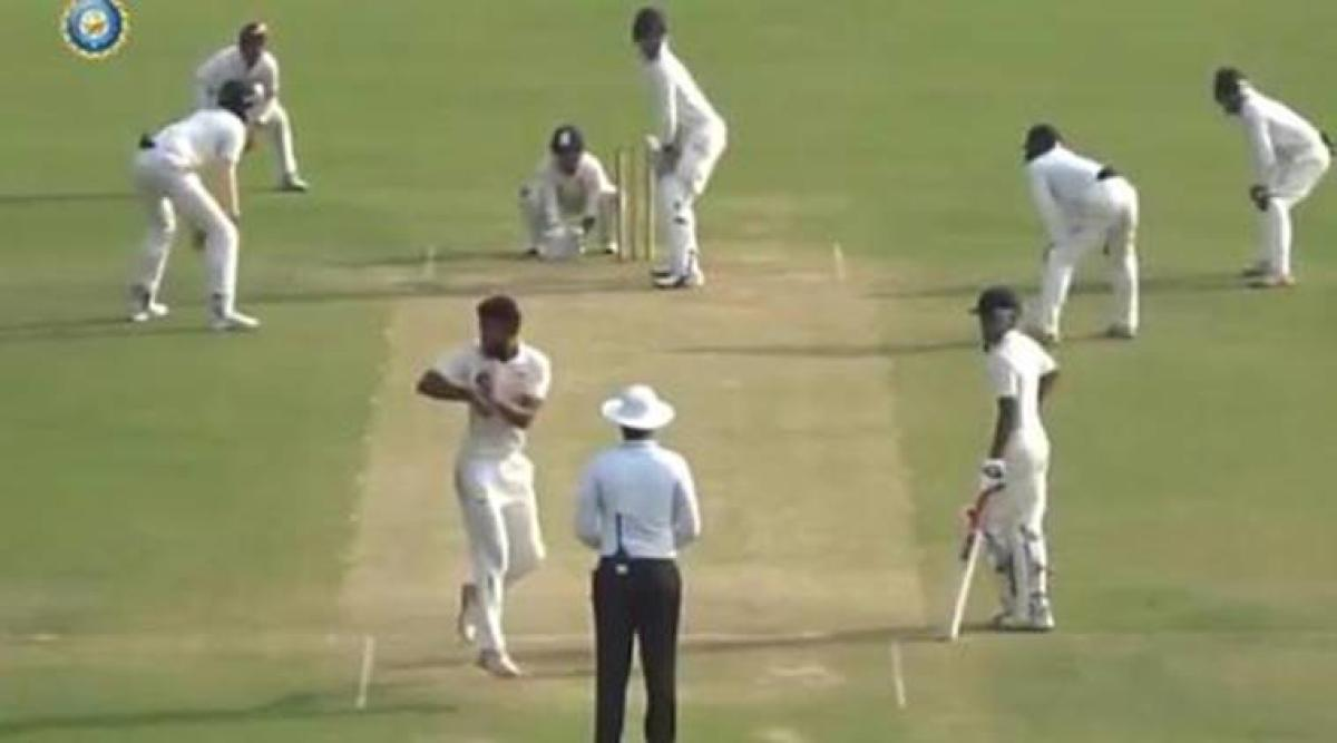 WHAT'S THIS? Uttar Pradesh's Shiva Singh does a 360-degree turn before delivering the ball.