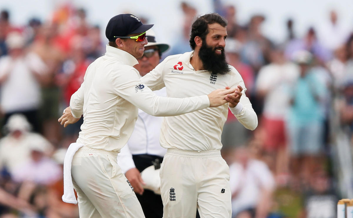 England's Moeen Ali (right) celebrates with team-mate Jos Buttler after desmissing Sri Lanka's Dimuth Karunaratne on the fourth day of the first Test in Galle on Friday. Reuters