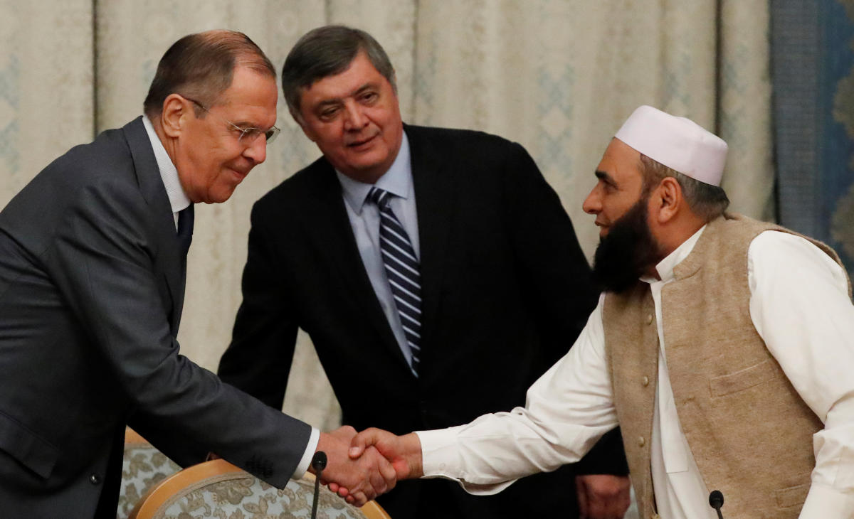 Russian Foreign Minister Sergei Lavrov welcomes member of Taliban delegation Alhaj Mohammad Sohail Shaina during the multilateral peace talks on Afghanistan in Moscow, Russia on November 9, 2018. Reuters