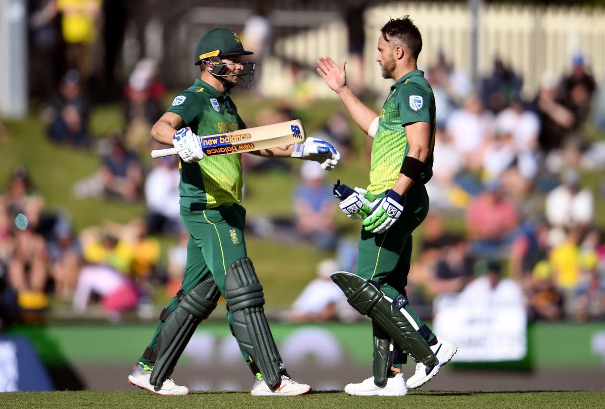 South Africa's David Miller (left) celebrates with team-mate Faf du Plessis after scoring a century against Australia in the third ODI on Sunday. AFP