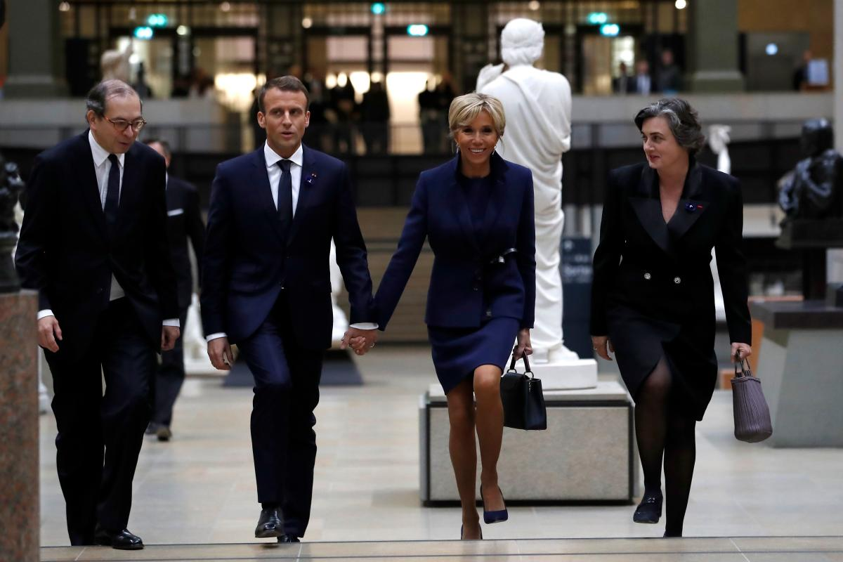 French president Emmanuel Macron and his wife Brigitte Macron arrive at the Musee d'Orsay in Paris on November 10, 2018 to attend a state diner and a visit of the Picasso exhibition as part of ceremonies marking the 100th anniversary of the 11 November 1918 armistice, ending World War I. AFP
