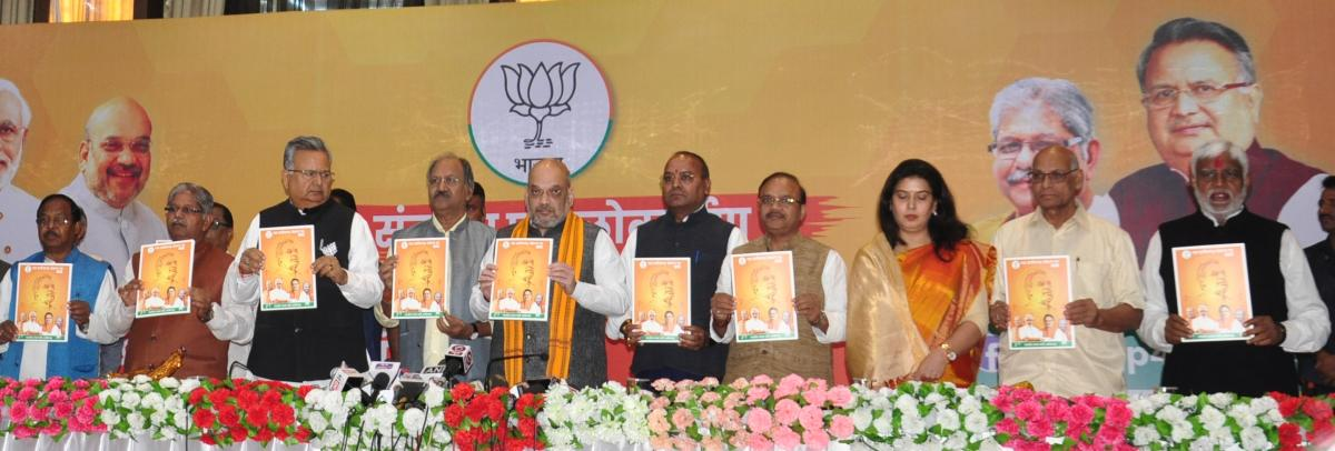 BJP president Amit Shah, Chhattisgarh Chief Minister Dr Raman Singh along with other leaders release their party's election manifesto for the poll-bound state.