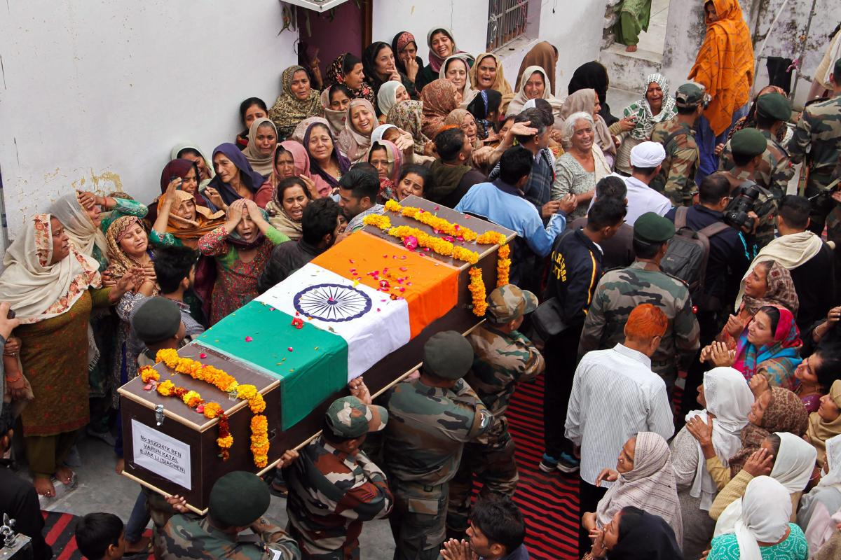 Army jawans carry the body of their colleague Varun Katal during his funeral at Village Mawa in Samba, about 55km from Jammu, on Sunday. Kattal was killed on Saturday in a sniper fire during a ceasefire violation by Pakistan along the Line of Control.