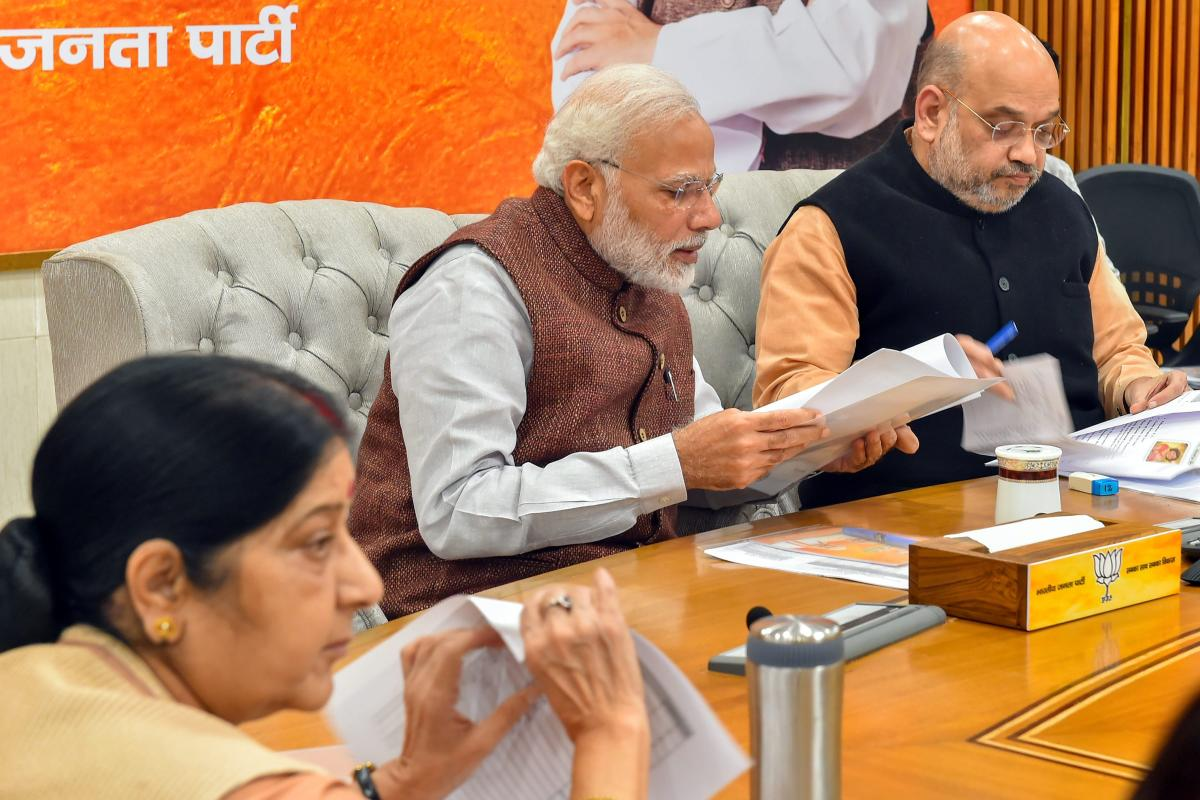 Prime Minister Narendra Modi, BJP president Amit Shah and External Affairs Minister Sushma Swaraj during the party's Central Election Committee meeting for the forthcoming Assembly polls in Rajasthan at party headquarters in New Delhi on Sunday. PTI