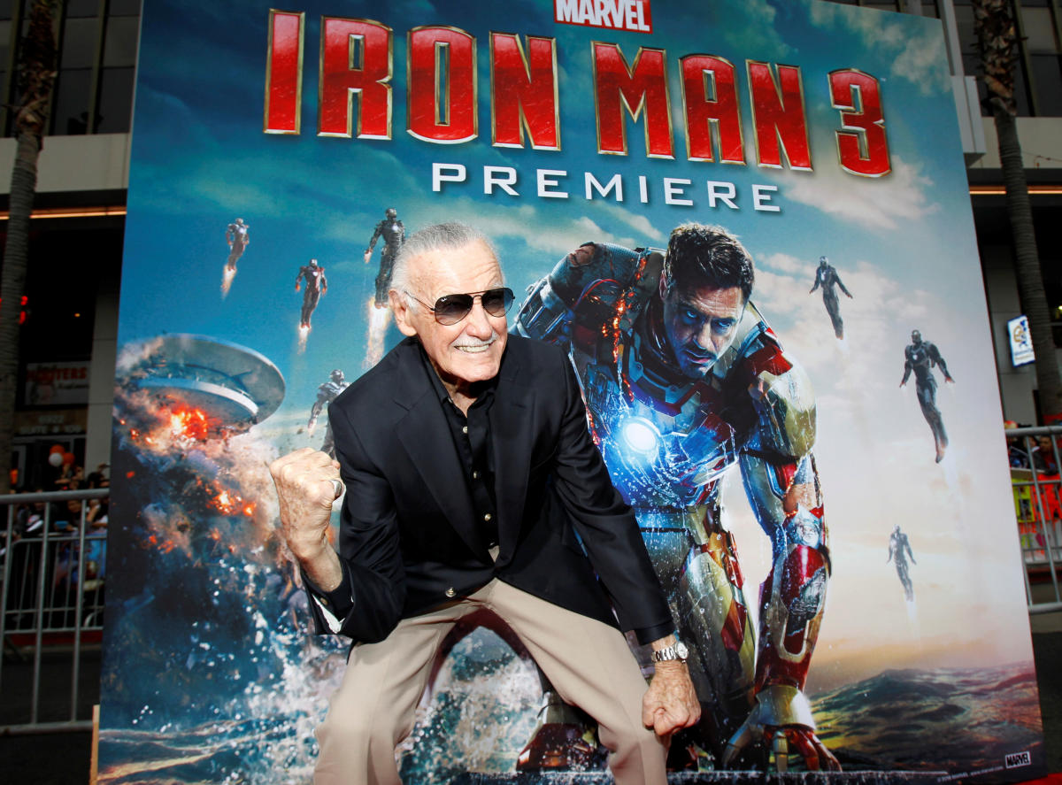 """Stan Lee gestures as he poses at the premiere of """"Iron Man 3"""" at El Capitan theatre in Hollywood, California, US (REUTERS File Photo)"""