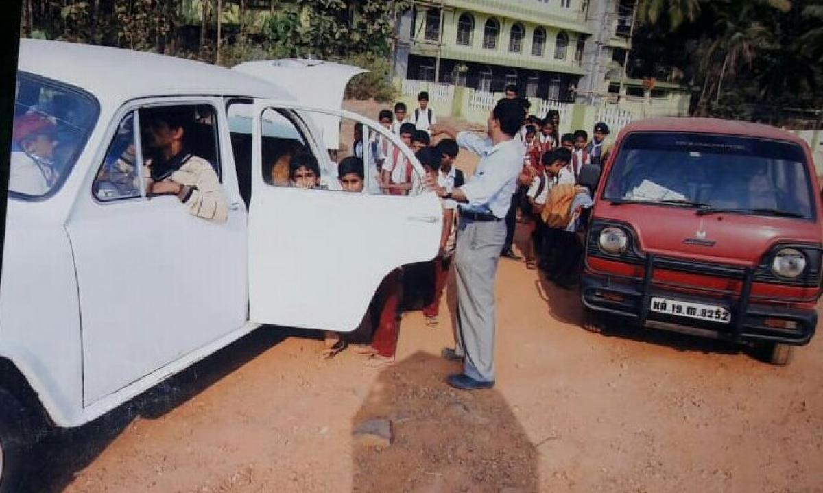 Children of Darul Islam Aided Higher Primary School board vehicles to reach their homes.