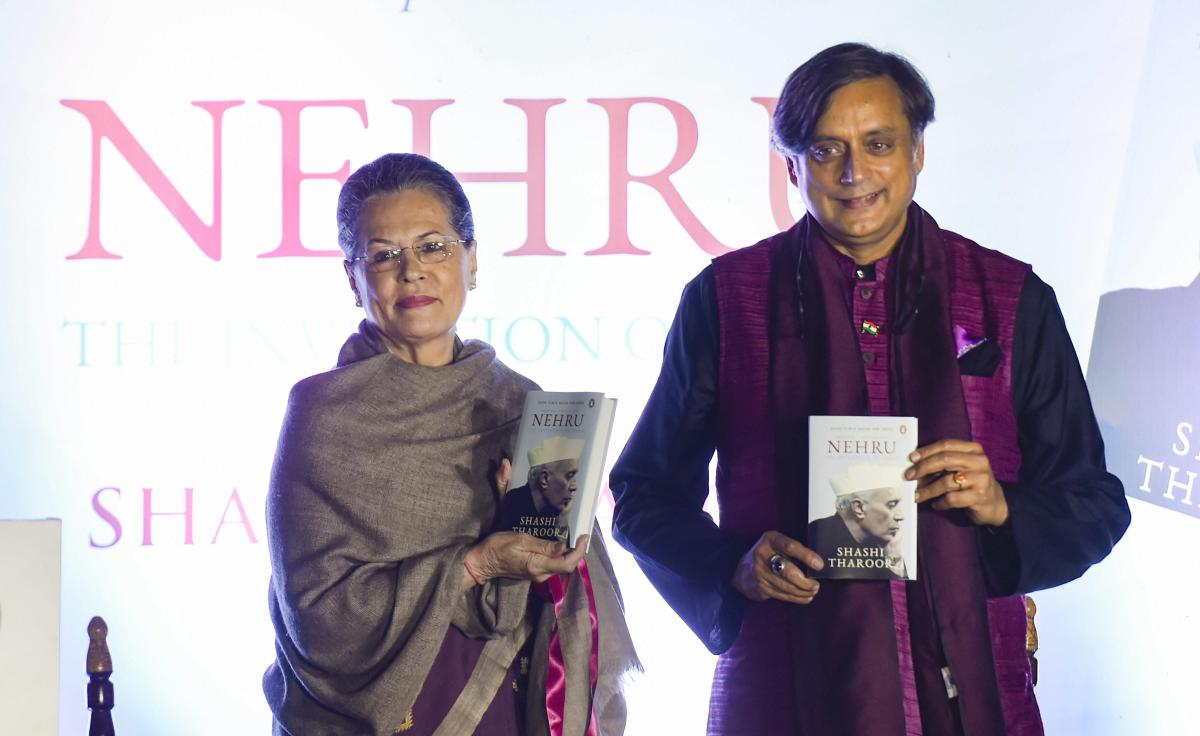 Former Congress President Sonia Gandhi with Congress MP Shashi Tharoor during latter's book 'Nehru: The Invention of India' launch event, in New Delhi, Tuesday, Nov 13, 2018. (PTI Photo)