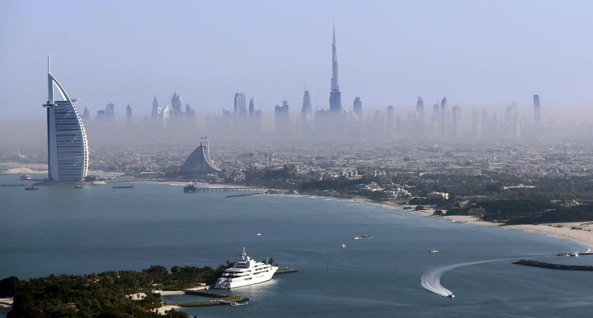Burj Khalifa, the world's tallest tower, and luxury Burj al-Arab Hotel (L) are seen in a general view of Dubai, UAE December 9, 2015. Picture taken December 9, 2015. REUTERS