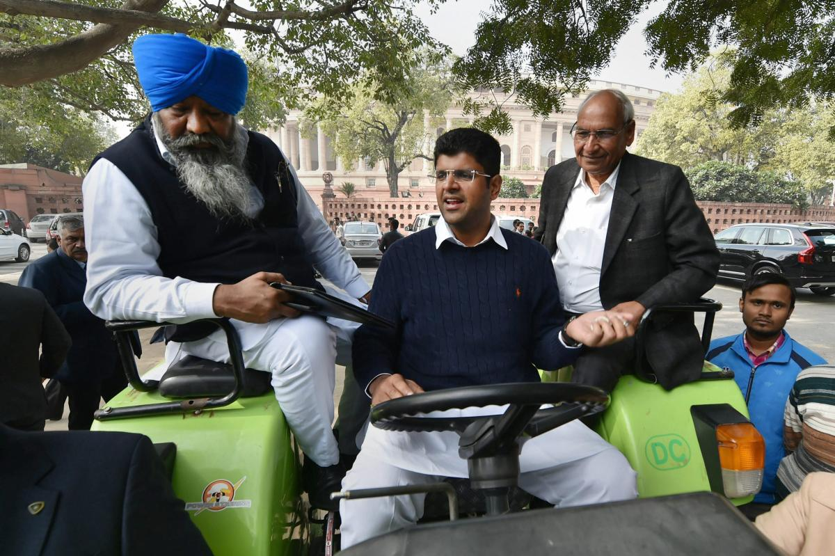 INLD MP Dushyant Chautala arrives by a tractor to attend the winter session of Parliament. PTI/FILE