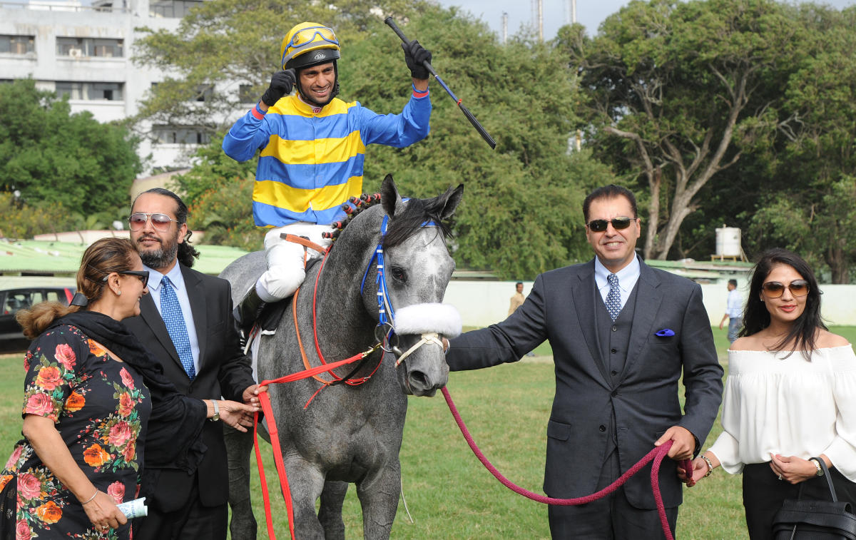 Sir Cecil (P Trevor astride) is led in by owners (from left) Harsimran, Karan Brar and Tegbir Brar after the colt clinched the Kingfisher Ultra Derby at the Bangalore Turf Club on Sunday. (DH PHOTOS/ SRIKANTA SHARMA R)