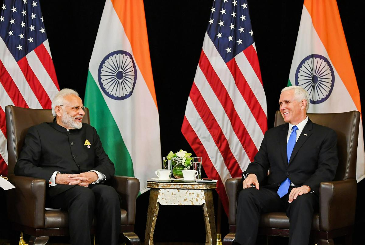 Prime Minister Narendra Modi (L) and the US Vice President Michael Richard Pence, on the sidelines of East Asia Summit in Singapore on Wednesday. PTI photo