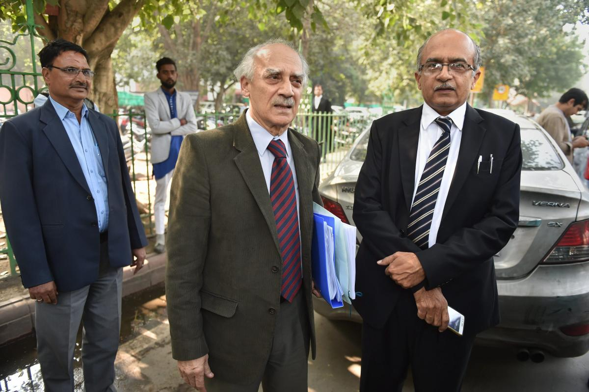 Senior lawyer Prashant Bhushan with former union minister Arun Shourie at the Supreme Court during a hearing on Rafale deal, in New Delhi, Wednesday. PTI photo