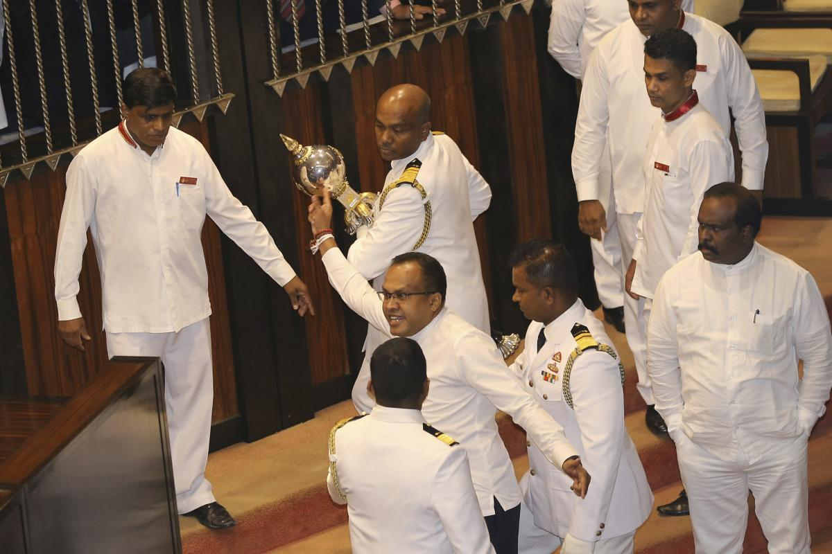 Udaya Padmashantha, member of the United Peoples Freedom Alliance (UPFA) that supports Prime Minister Mahinda Rajapaksa, is stopped from grabbing a mace after a no-confidence vote in Colombo, Sri Lanka. AP/PTI photo