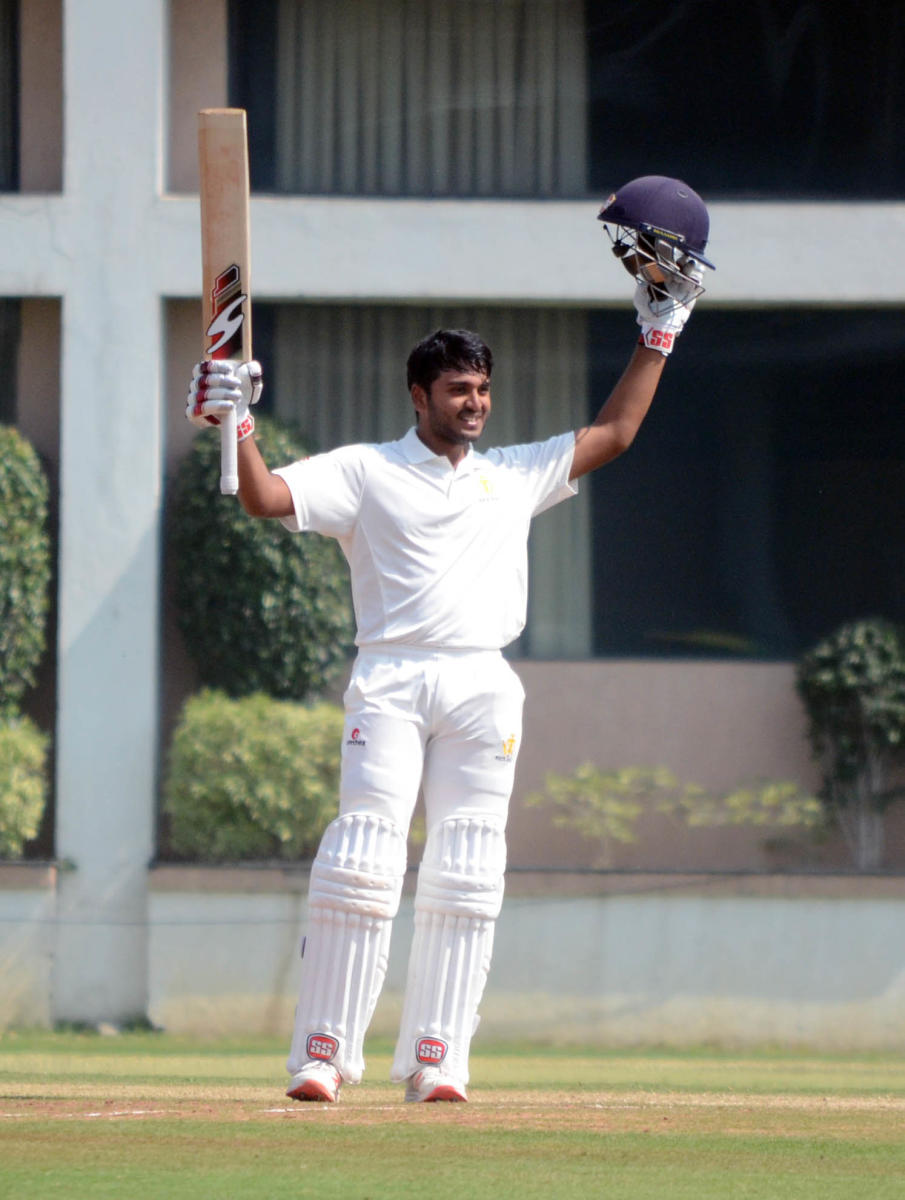 Karnataka's B R Sharath celebrates after completing his ton on his debut on the third day of their Ranji Trophy match against Vidarbha in Nagpur on Wednesday.