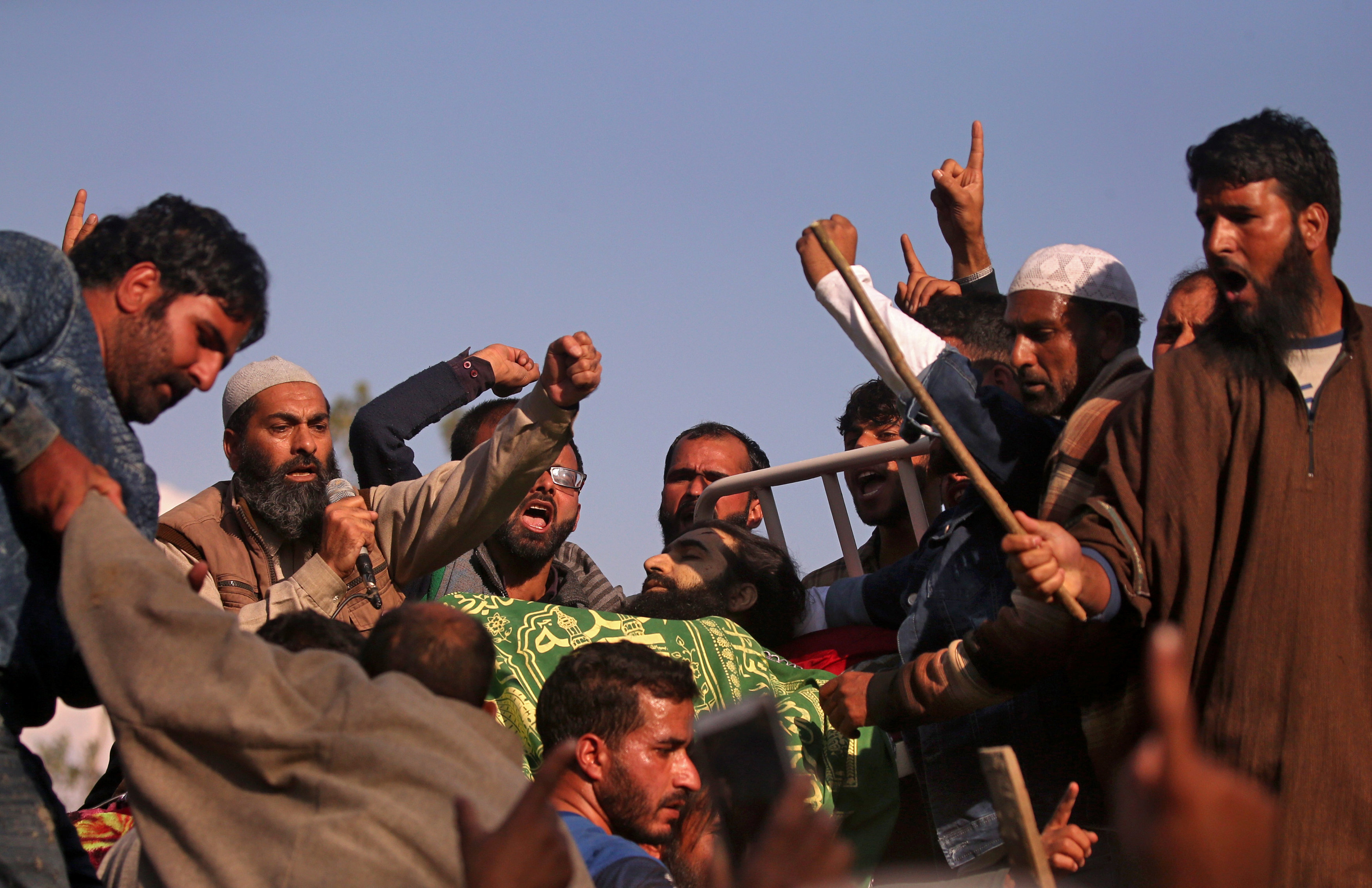 People shout slogans around the body of Sabzar Ahmad Sofi, a suspected militant, who was killed in a gun battle with the security forces on the outskirts of Srinagar, during his funeral procession in south Kashmir's Sangam town on Wednesday. REUTERS