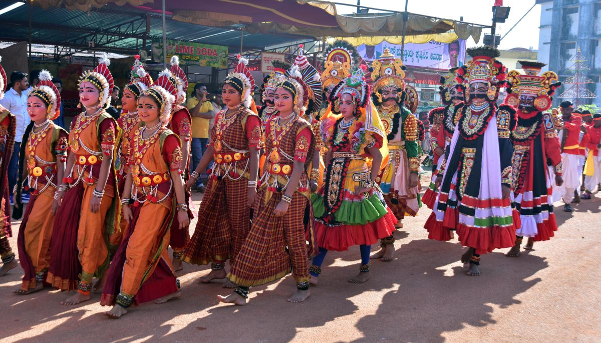 Artistes clad in Yakshagana attire take part in the procession, organised prior to the inauguration of the 15th edition of Alva's Nudisiri 2018 at Alva's Education Foundation (AEF) campus in Vidyagiri, Moodbidri, on Friday.