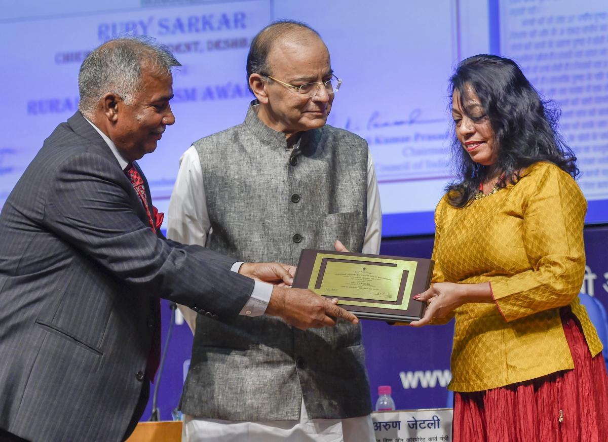 Finance Minister Arun Jaitley and Press Council of India Chairperson Justice Chandramauli Kumar Prasad present the 'Rural Journalism Award' to Chief Correspondent, Deshbandhu, Ruby Sarkar, during the National Press Day celebrations in New Delhi on Friday.