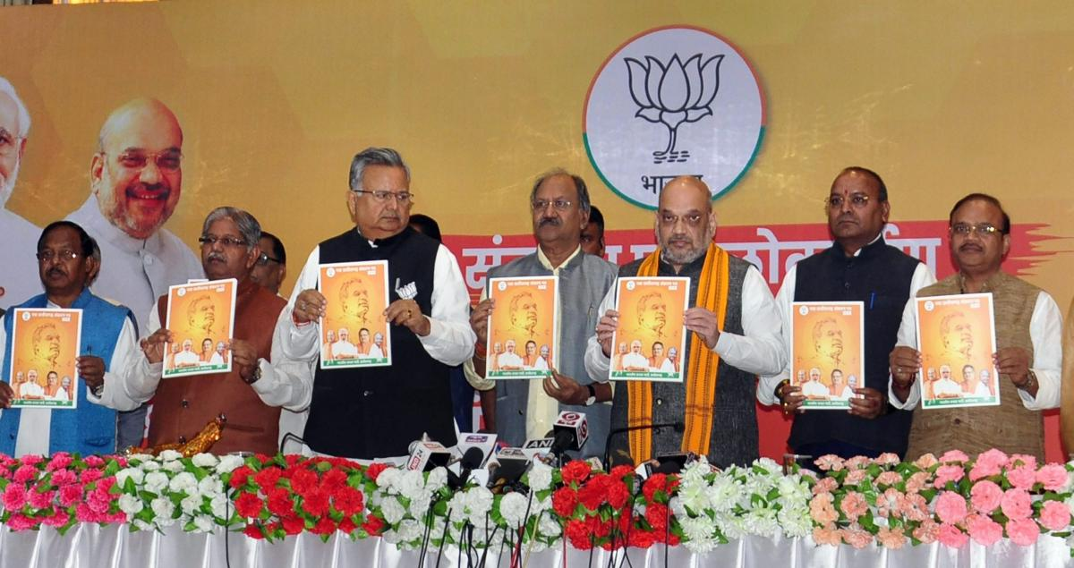 BJP President Amit Shah, Chhattisgarh Chief Minister, Raman Singh and party leaders during the release of the party's manifesto for Chhattisgarh Assembly elections, in Raipur. PTI