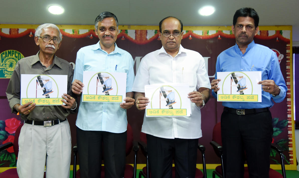 CAMPCO president SRSatishchandra (second from right) releases logo of the training programme for the first batch of unemployed youth at Varanashi towers on Friday.