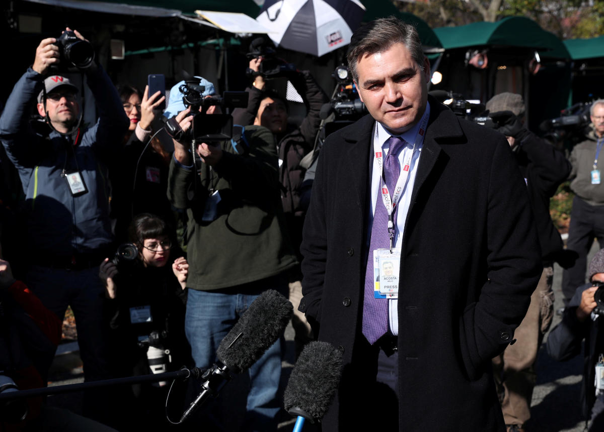 CNN correspondent Jim Acosta talks to reporters as he returns to work covering the White House after a federal court ruling in his favor led to his White House press pass being returned to him. Reuters