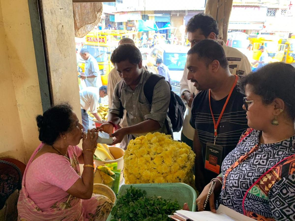 A Pulmonary Function Test being carried out on a flower vendor in Mangaluru.