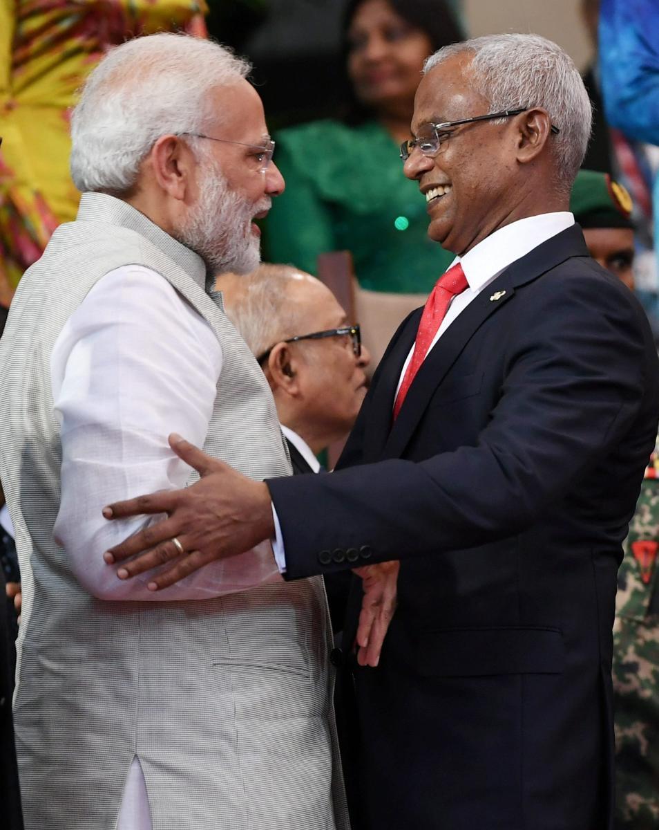Prime Minister Narendra Modi greets Maldives new president Ibrahim Mohamed Solih, in Male, Maldives, on Saturday. PTI