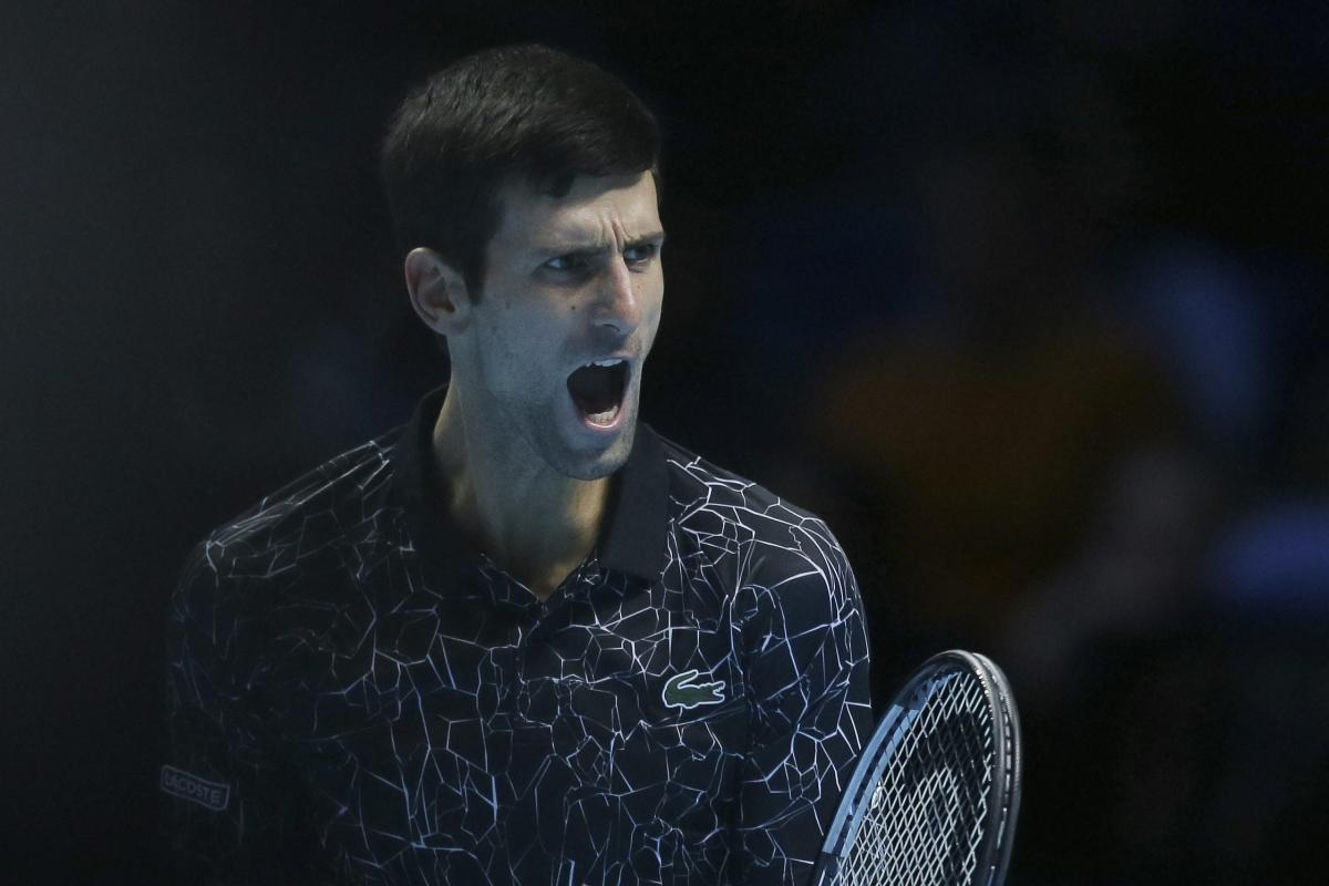 Serbian Novak Djokovic exults during his game against Kevin Anderson during an ATP World Tour Finals match on Saturday. AP/PTI