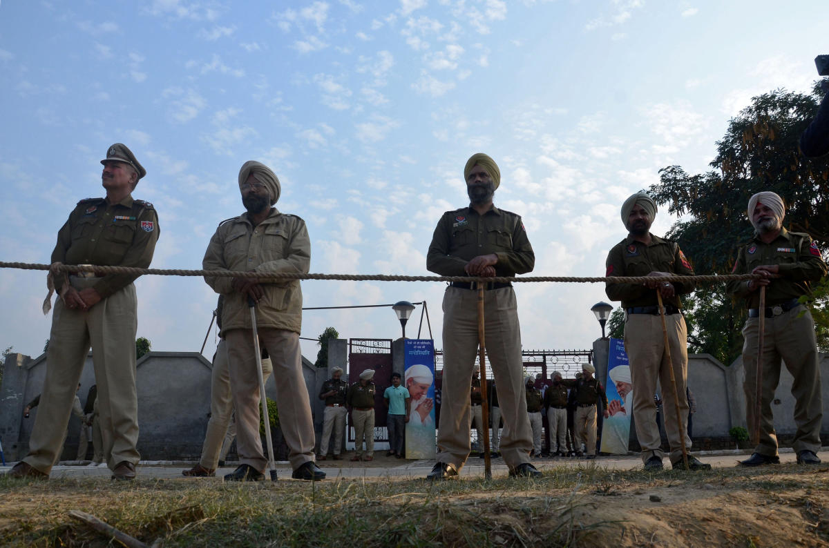 Police stand guard after a grenade blast outside a Sikh religious gathering site on the outskirts of Amritsar. Reuters photo