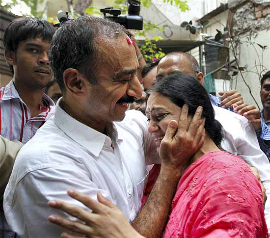 Suspended IPS officer Sanjiv Bhatt hugs his wife Shweta after his release from Sabarmati Central Jail. (Photo by PTI)