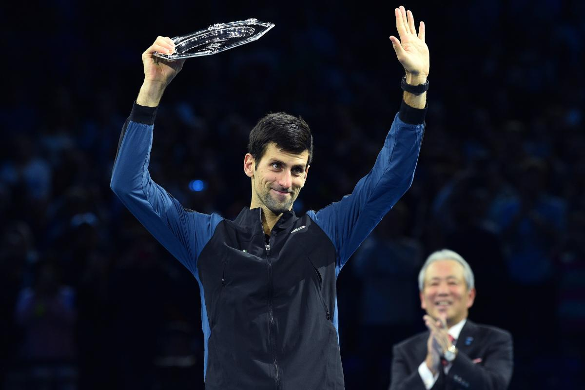 Serbia's Novak Djokovic waves to the crowd holding his runners-up trophy after losing to Germany's Alexander Zverev in the title cash of the ATP Finals. AFP
