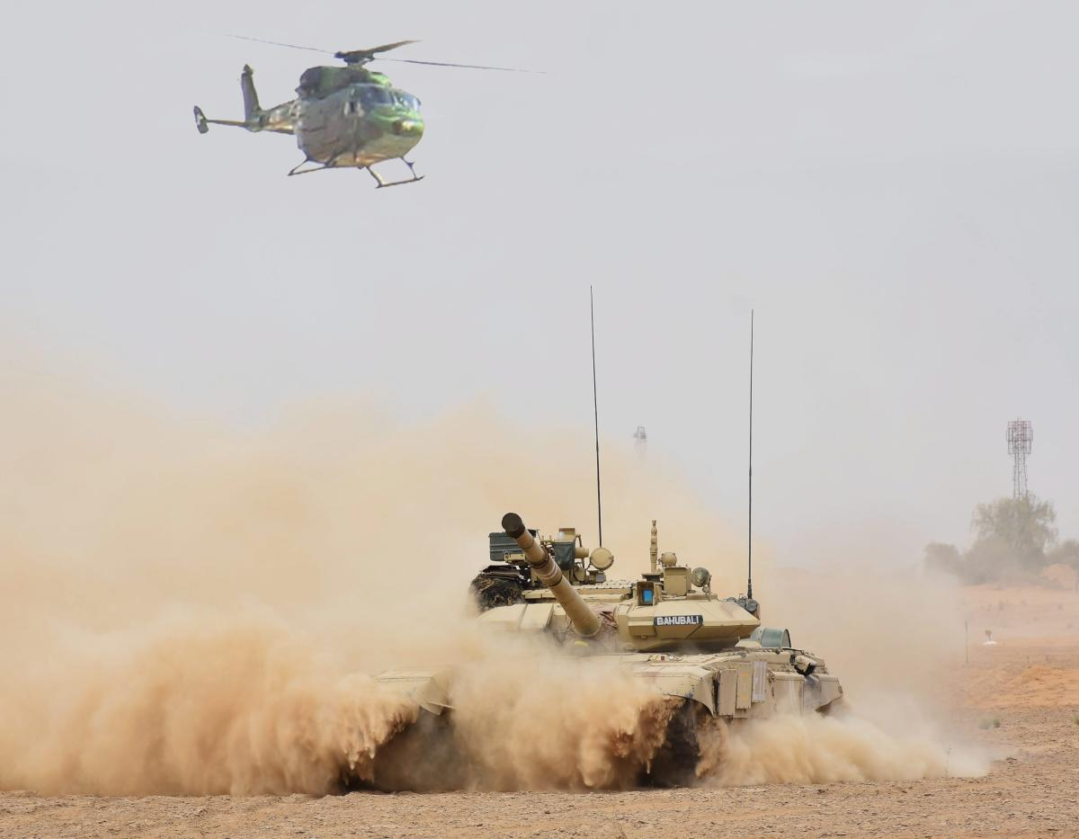 A helicopter and a tank in coordinated action during the practice of 'Air Cavalry' concept in recently concluded exercise 'Vijay Prahar' at Mahajan Field Firing Range in Rajasthan. PTI file photo