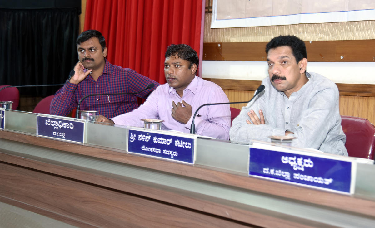 Deputy Commissioner Sasikanth Senthil (centre) speaks at the Development Coordination and Monitoring Committee meeting in Mangaluru recently.