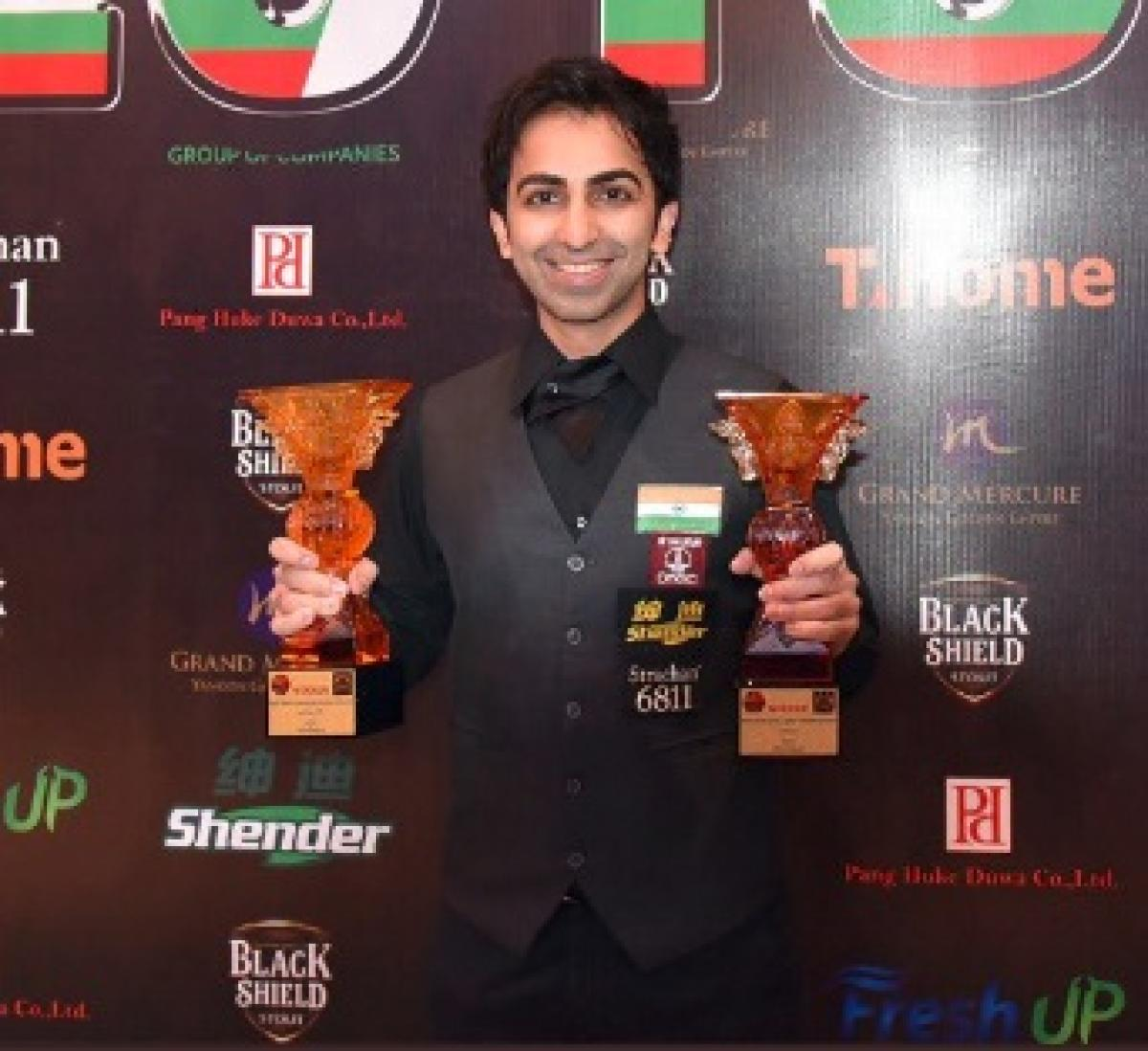 Pankaj Advani poses with the long and points format titles which he won in theongoing IBSF World Billiards Championship. TWITTER